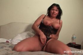 Tanned mature riding a huge dildo up slit