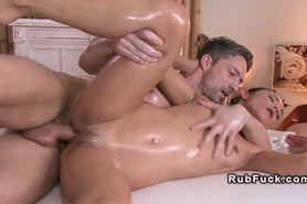 Oiled couple in massage room nuru cumshot