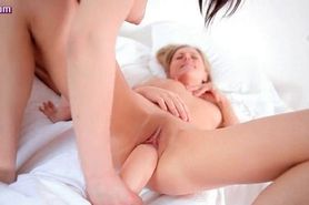 Lesbians playing with massive dildo
