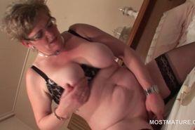 Busty blonde mature riding her fat dildo