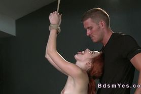 Tied up redhead sub gets spanked