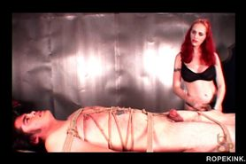 Tied to the table male sex slave gets teased