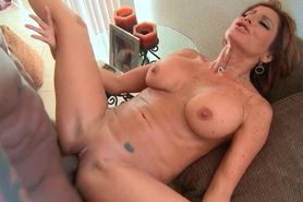 Slutty MILF enjoying a massive black cock drilling her