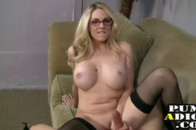 Blonde MILF with glasses gives handjob