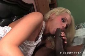 Little blonde blowing monster black dick in bed