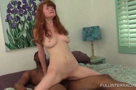Tiny redhead riding monster black schlong