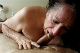 Brunette grandma sucking a cock