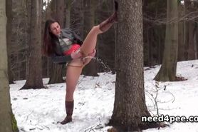 Crazy half naked chick pissing in snow