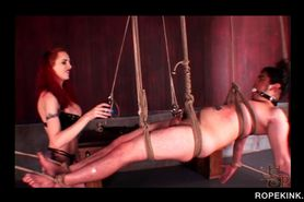 Male sex slave in ropes gets dick tortured
