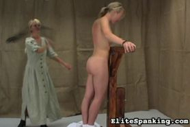 Naked woman is flogged.