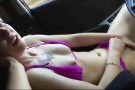 Teen beauty masturbating in the car