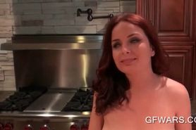 Busty redhead masturbates on kitchen table