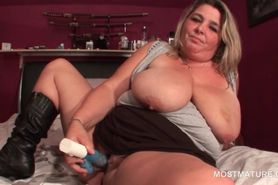 Blonde mature with giant tits dildo fucks herself with