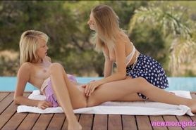 Two teen blondes Nomi and Maria Pie 69ing outdoors