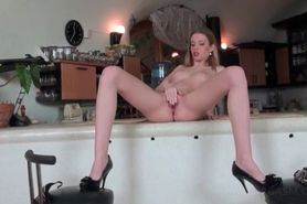 Wet pussy blonde on heels masturbates with glass dildo