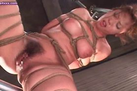 Tied up asian gets holes dildoed
