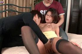 Asian with glasses getting a cock