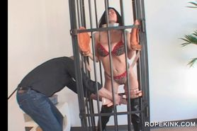 Caged brunette slut takes BDSM treatment