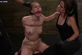 Tied up lesbian gets pussy drilled