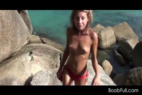 Topless blonde flashing small tits by the beach