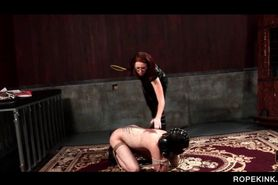 Male sex slave on knees gets butt spanked