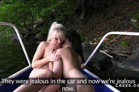 Lesbian amateur having fun in the boat on the lake