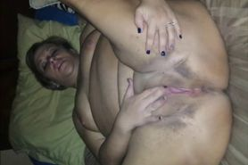 Shaved chunky MILF masturbates
