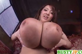Hitomi plays with gigantic boobs