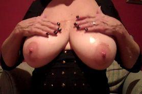 mature lady oils her big tits