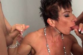 Muscle female sucking two cocks