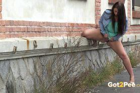 A cute girl peeing in public
