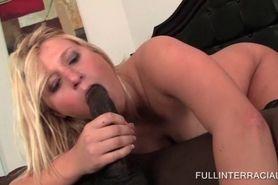 Blonde in stockings eats black dick in sixtynine