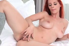 Teenage redhead doll exploring her hot assets in bed