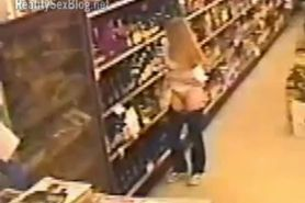 Woman Gets Caught Stuffing Wine Bottles