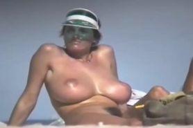 Busty woman on a nude beach
